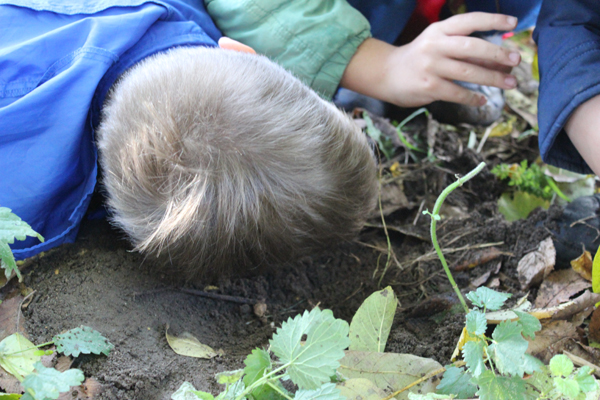 Children listening to the moles