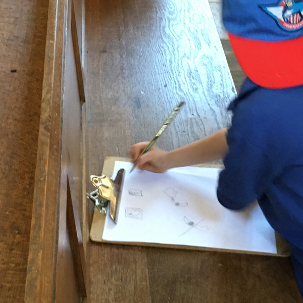 Child drawing in the church