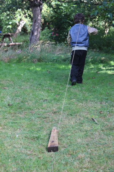 Making a trail with a piece of wood and string