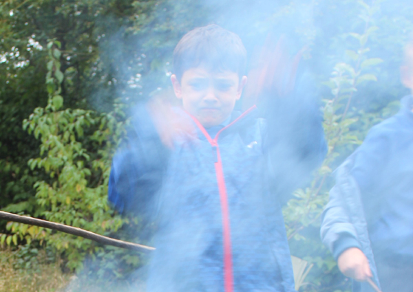 Boy seen through smoke