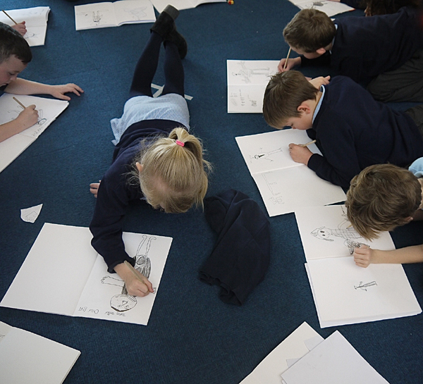 Pupils Alex working on their sketch books