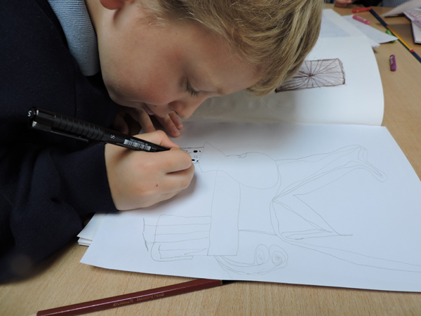 Child drawing creating Creatures