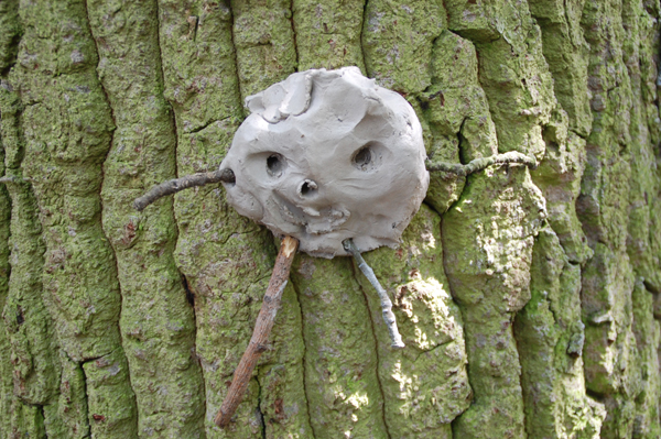 Clay man on a tree
