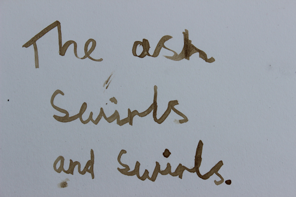 Image of writing with the ink 'The ash swirls and swirls'