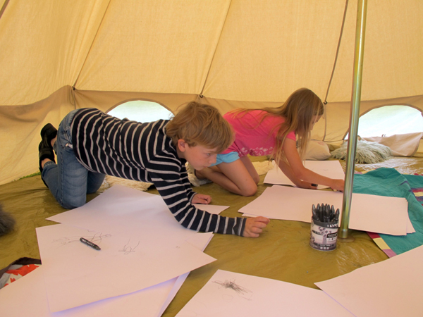 Children drawing in the Tent of Sounds